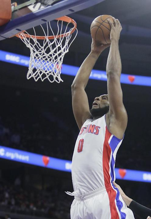 Detroit Pistons' Andre Drummond (0) goes up to dunk against the Atlanta Hawks during the first half of an NBA basketball game Tuesday, March 31, 2015, in Auburn Hills, Mich. (AP Photo/Duane Burles