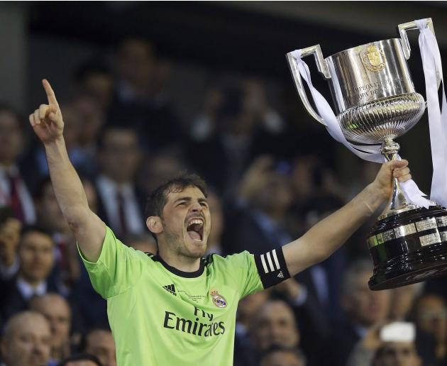 Real Madrid's Casillas lifts up the King's Cup after they defeated Barcelona in their final soccer match at Mestalla stadium in Valencia