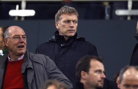 Manchester United's coach David Moyes watches the German first division Bundesliga soccer match between Borussia Moenchengladbach and Bayern Munich in Moenchengladbach January 24, 2014. REUTERS/Ina Fassbender