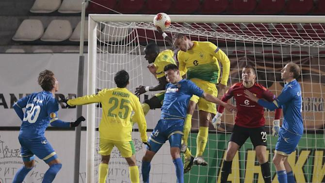 Tromso's Thomas Bendiksen, center, fails to head the ball past Anzhi's Benoit Angbwa, top left, and Ewerton, top right, during the Europa League group K soccer match between Anzhi Makhachkala and Tromso IL at Saturn stadium in Ramenskoye, outside Moscow, in Russia, on Thursday, Oct. 24, 2013