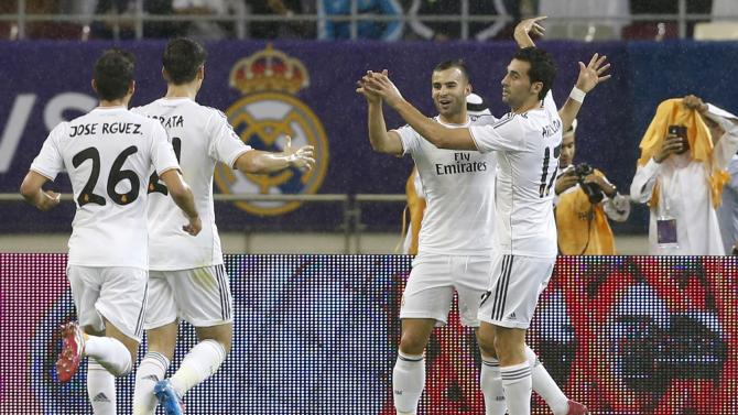 Real Madrid's Jese celebrates with teammates after scoring against Paris St Germain during their friendly soccer match at Khalifa stadium in Doha