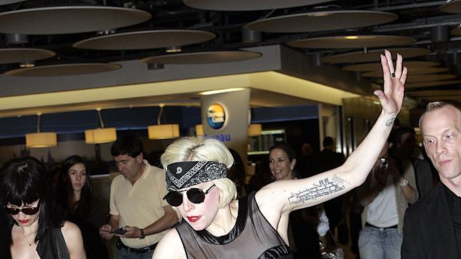 Lady Gaga Trips At Heathrow