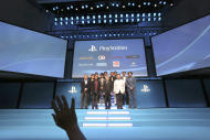 Special guests from Sony and computer game companies pose at the stage at SCEJA press conference in Tokyo, Monday, Sept. 1, 2014. Sony is trying to woo Japanese game fans to the PlayStation 4 home console that went on sale in November in the U.S. and Europe, but didn't arrive at stores here until February. (AP Photo/Eugene Hoshiko)