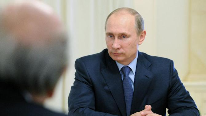 Russian President Vladimir Putin meets with FIFA President Sepp Blatter and Russian gas monopoly Gazprom Head Alexei Miller in the Black Sea resort of Sochi, Russia, Saturday, Sept. 14, 2013