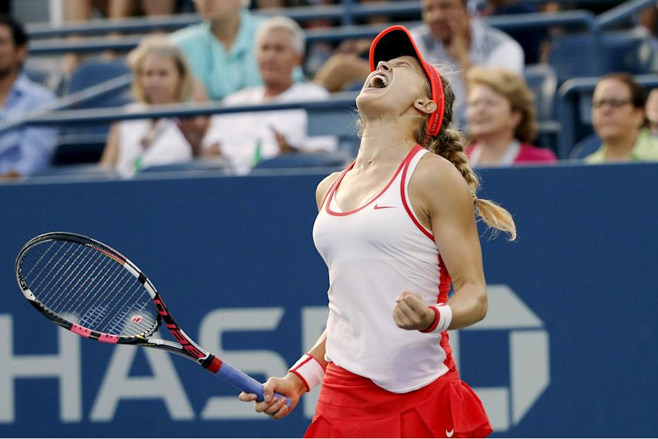 Bouchard of Canada celebrates her win over Cibulkova of Slovakia in their women's singles third round match at the U.S. Open Championships tennis tournament in New York