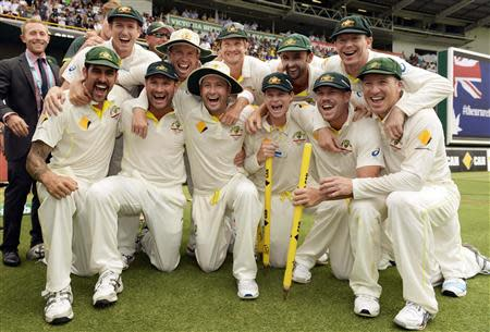 Australia's players celebrate after they won their third Ashes test cricket match against England at the WACA ground in Perth