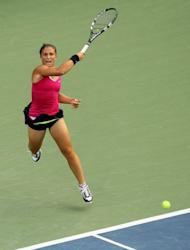 Sara Errani of Italy returns a shot during her women's singles semifinal match against Serena Williams at the 2012 US Open on September 7, 2012 in New York City