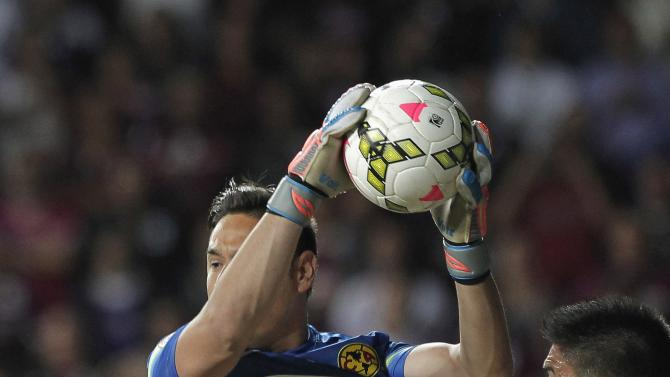 Goalkeeper Moises Munoz of America blocks the ball  during their CONCACAF Champions League soccer match against Deportivo Saprissa in San Jose