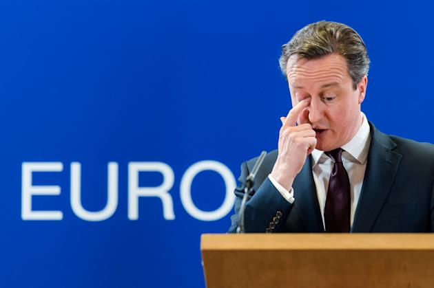 British Prime Minister David Cameron addresses the media after an EU summit in Brussels on Friday, March 20, 2015. EU leaders on Friday are looking to back U.N.-brokered efforts to form a national uni