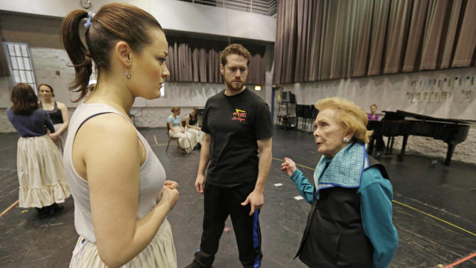 "In this April 26, 2013 photo, choreographer Gemze de Lappe, right, talks with leading lady Ashley Brown, who portrays Laurey in Rodgers and Hammerstein's ""Oklahoma!"" at the Lyric Opera of Chicago during a rehearsal as associate choreographer Victor Wisehart looks on. De Lappe first danced in ""Oklahoma!"" in 1943 as a member of the Broadway hit's first national touring company and now 70 years later at age 91 she's choreographing a production of the musical at the Lyric. (AP Photo/M. Spencer Green)"