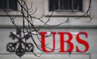 Swiss banking giant UBS's net profit slid by 54 percent to 827 million Swiss francs (688 million euros, $910 million) in the first quarter of 2012, significantly below expectations, it said on Wednesday