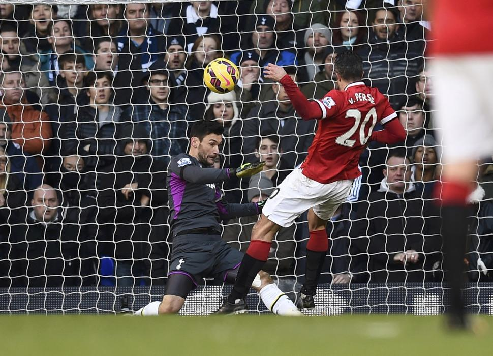 Manchester United's Robin van Persie fails to score past Tottenham Hotspur's Hugo Lloris during their English Premier League soccer match at...