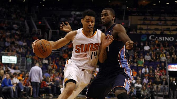 Phoenix Suns shooting guard Gerald Green (14) drives against Charlotte Bobcats small forward Michael Kidd-Gilchrist (14) in the fourth quarter during an NBA basketball game on Saturday, Feb. 1, 2014, in Phoenix