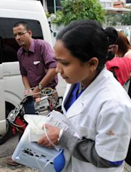 Members of an Indian medical team leave the Mount Elizabeth Hospital in Singapore, on December 27, 2012. An Indian student who was left fighting for her life after being brutally gang raped on a bus in New Delhi arrived in Singapore for further medical treatment