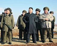 This undated photo released by North Korea's official Korean Central News Agency (KCNA) on February 23, 2013 shows North Korean leader Kim Jong-Un (C) during a flight exercise and a paratrooping drill of the Air Force and Anti-Air Force and Large Combined Unit 630