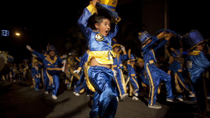 "Members of the murga ""Los amantes de La Boca"" perform during carnival celebrations in Buenos Aires, Argentina, Saturday, Feb. 2, 2013. Argentina's carnival celebrations may not be as well-known as the ones in neighboring Uruguay and Brazil, but residents of the nation's capital are equally passionate about their ""murgas,"" or traditional musical troupes. The murga ""Los amantes de La Boca,"" or ""The Lovers of The Boca"" is among the largest, with about 400 members. It's a reference to the hometown Boca Juniors, among the most popular soccer teams in Argentina and the world. (AP Photo/Natacha Pisarenko)"