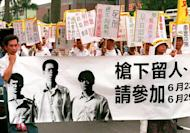 Taiwanese activists unfurl a banner with the image of three death-row convicts during a 1999 rally in Taipei. The murder of a 10-year-old boy whose throat was slit in a Taiwan playground has reignited a debate over the death penalty after the suspect reportedly said he was anticipating free board and lodging in jail