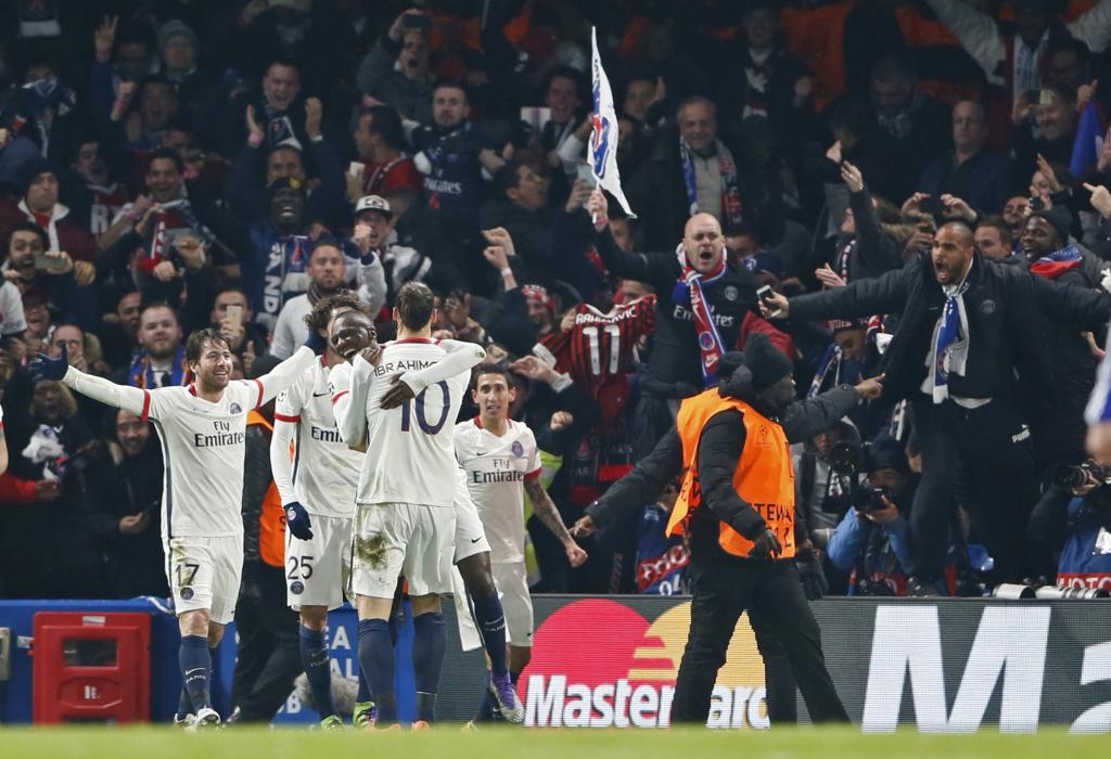 Zlatan Ibrahimovic celebrates with team mates and fans after scoring the second goal for PSG