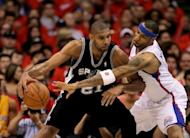 Tim Duncan (L) of the San Antonio Spurs controls the ball against Kenyon Martin of the Los Angeles Clippers during the 2012 NBA playoffs at Staples Center in Los Angeles, California. The Spurs won 96-86 to take a three games to none lead in the series