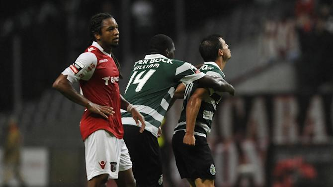 Sporting's Cedric Soares, right, celebrates with William Carvalho after scoring his team second goal past Sporting Braga's Alan Silva, from Brazil, during their Portuguese League soccer match at the Municipal Stadium, in Braga, Portugal, Saturday Sept. 26, 2013. Cedric Soares scored once in Sporting's 2-1 victory