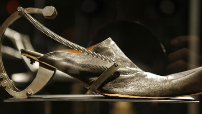 "This Feb. 11, 2013 photo shows Kei Kagami's oxidized metal and leather footwear on display at the ""Shoe Obsession"" exhibit at The Museum at the Fashion Institute of Technology Museum in New York. The exhibition, showing off 153 specimens, runs through April 13. (AP Photo/Kathy Willens)"