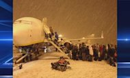 Weather: Flights Delayed After Snow In London