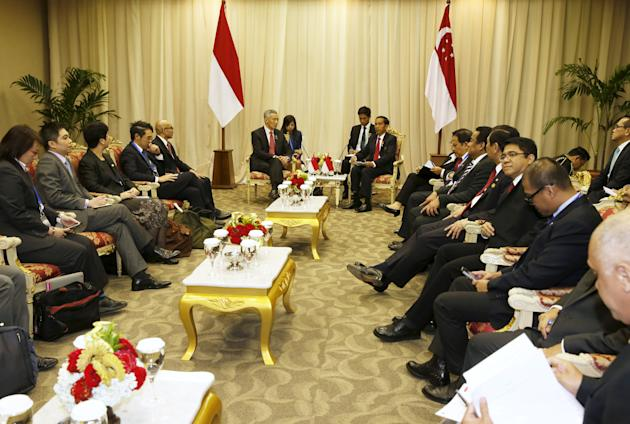 Singapore's PM Lee talks with Indonesia's President Widodo during bilateral meeting at Asian African Conference in Jakarta