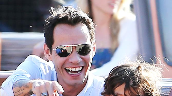 Marc Anthony with his girlfriend and his twins at Disneyland, CA