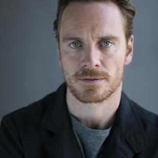"""FILE - In this April 30, 2015 file photo, German-Irish actor Michael Fassbender poses for a portrait to promote his film """"Slow West"""" in New York. Fassbender doesn't know if the """"Macbeth"""" curse carries over to movie adaptations, but he'd rather not test it. Fassbender's """"Macbeth"""" adaption is set to premiere Saturday, May 22, 2015 at the Cannes Film Festival. (Photo by Scott Gries/Invision/AP, File)"""