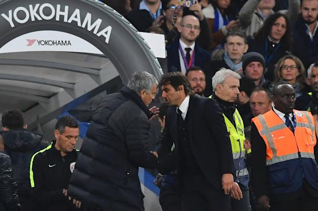 Chelsea's head coach Antonio Conte (R) shakes hands with Manchester United's manager Jose Mourinho after the final whistle at Stamford Bridge in London on October 23, 2016