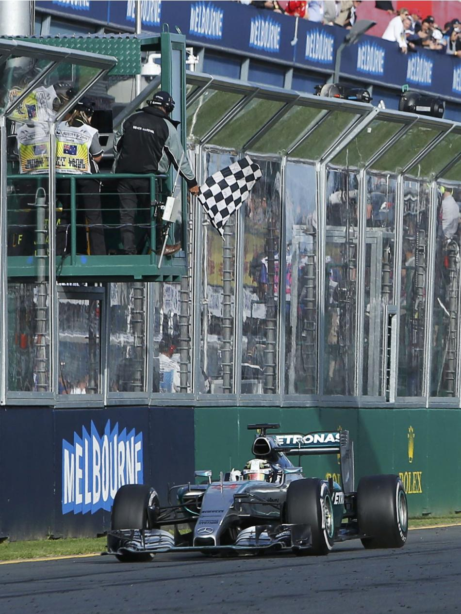 Mercedes Formula One driver Lewis Hamilton of Britain takes the chequered flag during the Australian F1 Grand Prix at the Albert Park circuit in Melbourne
