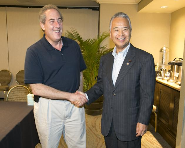 U.S. Trade Rep. Fromam and Japan's Trade Minister Amari, greet each other during meetings for the TPP in Lahaina