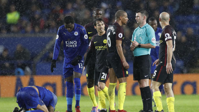 Manchester City's Fernando recieves a yellow card from referee Michael Oliver for a foul on Leicester City's Danny Simpson