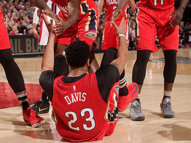 Anthony Davis, and eight arms to hold him. (Getty Images)