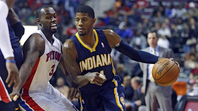 Detroit Pistons guard Rodney Stuckey (3) tries to stay with Indiana Pacers forward Paul George, right, during the first half of an NBA basketball game Tuesday, Nov. 5, 2013, in Auburn Hills, Mich