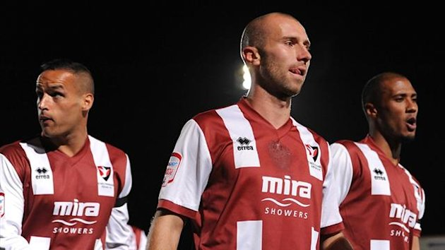 Cheltenham Town's Kaid Mohamed, Russell Penn and Chris Zebroski (left to right) (PA Photos)