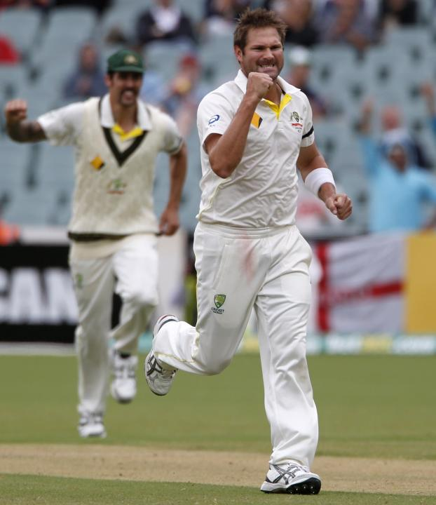 Australia's Harris celebrates after taking the wicket of England's Swann during the fifth day's play in the second Ashes cricket test at the Adelaide Oval