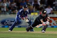 New Zealand's Brendon McCullum bats as England's Jos Buttler looks on during the one day international cricket match in Hamilton on Febuary 17, 2013. McCullum led New Zealand to a dramatic three-wicket win over England with heroic support from an injured Martin Guptill