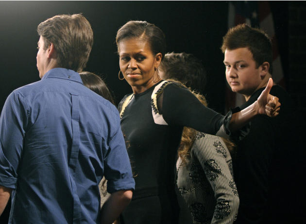 "First lady Michelle Obama gives a thumbs-up to students as she joins the cast of Nickelodeon's iCarly in filming a public service announcement following at a special screening of ""iMeet The First Lady"