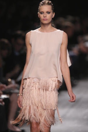A model wears a creation from British fashion designer  Peter Copping for Nina Ricci  ready to wear Spring-Summer 2013 collection, presented in Paris, Thursday, Sept. 27, 2012. (AP Photo/Jacques Brinon)