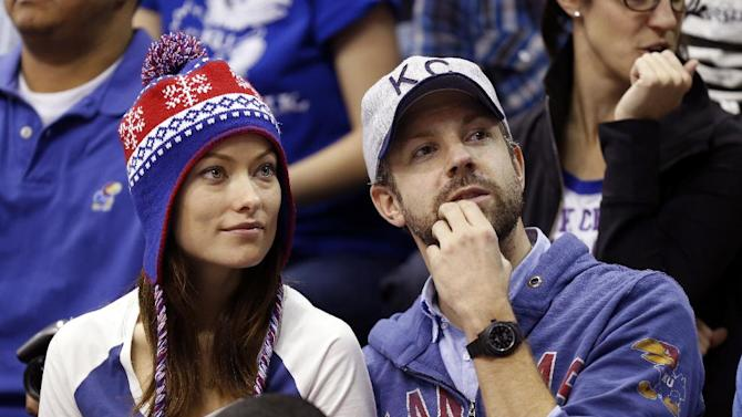 In this Dec. 29, 2012 file photo provided by Kansas University, actress Olivia Wilde, left, and actor Jason Sudeikis watch Kansas play American in an NCAA college basketball game in Lawrence, Kan. Olivia Wilde and Jason Sudeikis are getting married. A spokeswoman for Wilde confirmed Saturday, Jan. 12, 2013  that the couple is engaged.(AP Photo/Kansas University, Jeff Jacobsen, File)