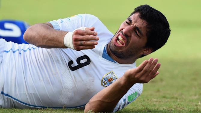 World Cup - Suarez banned from all football for four months