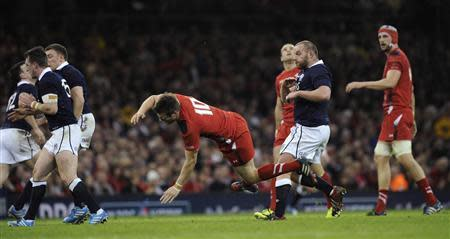 Wales' Biggar is hit by Scotland's Hogg during their Six Nations Championship rugby union match in Cardiff