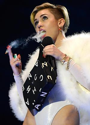 Miley Cyrus Smokes a Joint Onstage at the MTV EMAs While Accepting Best Video Award