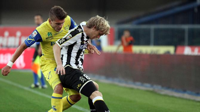 Udinese's Dusan Basta, right, of Serbia is challenged by Chievo forward Alberto Paloschi during a Serie A soccer match at Bentegodi stadium in Verona, Italy, Saturday, Sept. 21, 2013