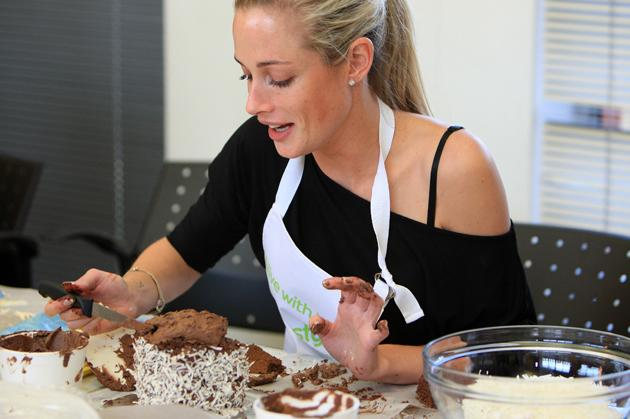 Reeva Steenkamp with the cake she baked at the BBC Lifestyle launch of 'Bake-Off' (Gallo Images / Rex Features)