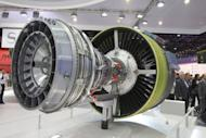 Visitors look at the LEAP engine by SAFRAN Snecma selected by Airbus to power the A320neo and by COMAC for the C919, at the International Paris Air Show on June 22, 2011. The C919 plane is a symbol of national pride which would compete with Boeing's 737 and the A320 of European consortium Airbus, but catching up might take at least a decade, industry officials and analysts said.