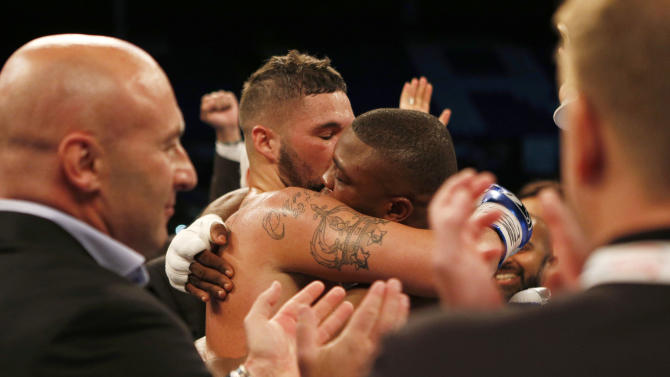 Tony Bellew consoles Ilunga Makabu after winning the fight