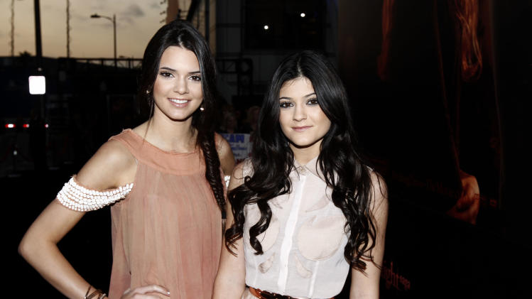 "Kendall, left, and Kylie Jenner arrive to the world premiere of ""The Twilight Saga: Breaking Dawn - Part 1"" on Monday, Nov. 14, 2011, in Los Angeles. (AP Photo/Matt Sayles)"