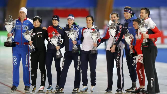 Overall winning athletes of competitions pose with their throphies during a ceremony at ISU World Cup Speed Skating Final competition in Erfurt